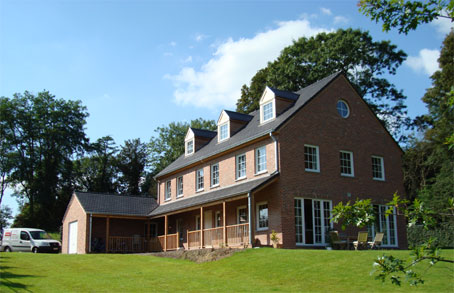Maison ossature bois waterloo conception et suivi de for Site de conception de maison