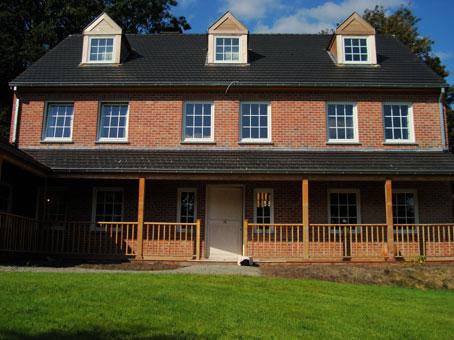 Maison ossature bois waterloo conception et suivi de for Conception maison bois